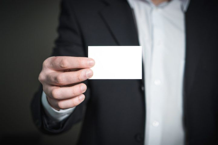 person-holding-white-paper-326569